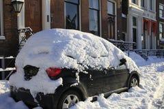 Snow covered car stock photos