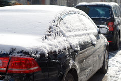Snow covered car Stock Images
