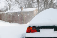 Snow covered car after blizzard. Snow covered car after heavy snow storm Stock Photos