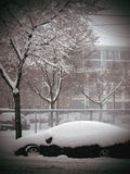 Snow Covered Car in City Storm Stock Photos