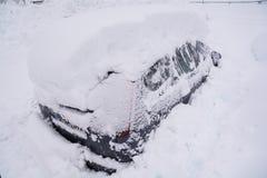 Snow covered car with deep snow. Snow covered car. Winter in the Austrian Alps. Heavy snowfall royalty free stock photos
