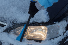 Snow covered car lights Royalty Free Stock Photo