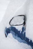 Snow-covered Car Mirror Stock Photo