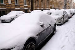 Snow covered car parked in streets of Zagreb Stock Images