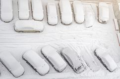 Snow covered car in the parking lot. Urban scene. After a snowstorm. Clean automobile from the snow. Snow-covered car in the parking lot. Urban scene. After a Royalty Free Stock Images