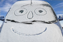 Snow-covered car with smiley Stock Photography