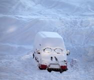 Snow-covered car with smiley in windshield Stock Photo