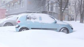 Snow covered car.snowstorm. Ukraine Kharkiv. snow covered car snowstorm stock video footage