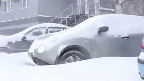 Snow covered car.snowstorm. Ukraine Kharkiv. snow covered car snowstorm stock footage