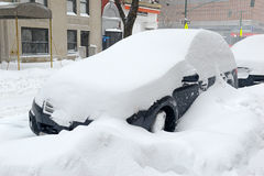 Snow covered car on street after winter snowstorm Stock Photography