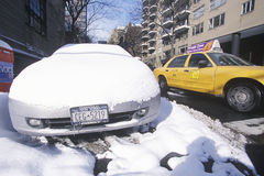 Snow covered car in streets of Manhattan, New York City, NY after winter snowstorm Royalty Free Stock Photo