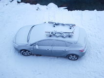 Snow covered car in winter. Overhead view of snow and ice covered car in winter Stock Photography