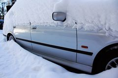 Snow-covered car by winter Royalty Free Stock Images