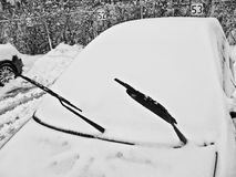 Snow covered car in winter Stock Photos