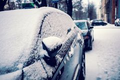 Snow covered car. Winter parking. Rearview mirror covered with snow royalty free stock images