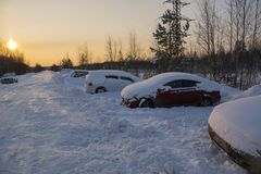 Snow covered cars after blizzard on a forest road Royalty Free Stock Photo