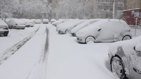 Snow covered cars. Snow in the parking stock video footage