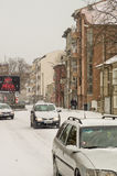 Snow covered cars on the street of Pomorie, Bulgaria royalty free stock photos