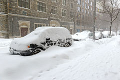 Snow covered cars on street after winter snowstorm Royalty Free Stock Photo