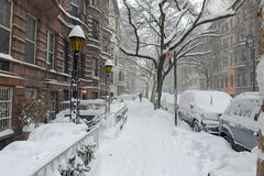 Snow covered cars on street after winter snowstorm Stock Images