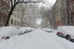 Snow covered cars on street after winter snowstorm Stock Image