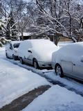 Snow covered cars stock photography