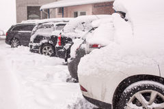 Snow-covered cars during a winter blizzard Stock Photo