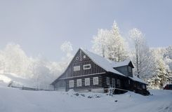 Snow covered chalet stock photo