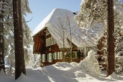 Snow covered chalet lodge in winter Royalty Free Stock Image