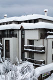 Snow covered chalets after the hard snowfall Royalty Free Stock Photo