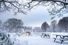 Snow Covered Children Playground in Grove Park. Children playground in Grove Park, Harborne is covered by snow Stock Photo