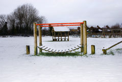 Snow covered childrens' playground. Sad snow covered playground with no children playing Royalty Free Stock Photos