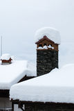 Snow covered chimney and roof Royalty Free Stock Image