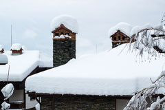 Snow covered chimney and roof. Snow covered chimney and chalet roof Royalty Free Stock Photography