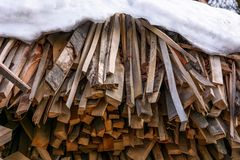 Chopped firewood background. Snow covered chopped firewood background royalty free stock photos