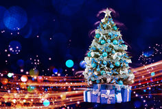 Snow Covered Christmas Tree with Multi Colored Lights Royalty Free Stock Photos