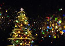 Snow Covered Christmas Tree with Multi Colored Lights Stock Photos