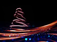 Snow Covered Christmas Tree with Multi Colored Lights. At Night Stock Photos
