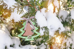 Snow-covered Christmas tree with toy Royalty Free Stock Image
