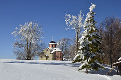 Snow covered church on mountain top Stock Images