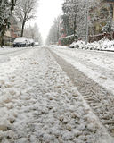 Snow-covered city street during a winter snowfall Royalty Free Stock Image