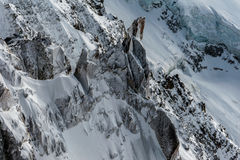 Snow covered cliffs and glacier crevasses in winter Royalty Free Stock Image