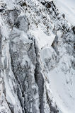 Snow covered cliffs and glacier crevasses in winter Stock Images