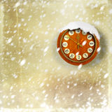 Snow-covered clock on gold background Stock Image