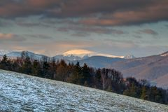 Snow-covered and cloud-capped peak Velka Fatra range Slovakia royalty free stock photos