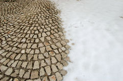 Snow-covered cobblestone floor Stock Photos