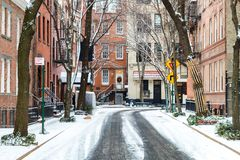 Snow covered Commerce Street after a winter storm in New York City. Snow covered Commerce Street after a winter storm in Greenwich Village Manhattan New York royalty free stock images