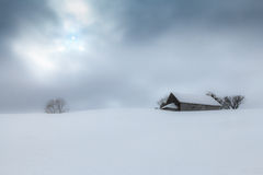 Snow covered cottage Stock Image