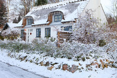 Snow covered cottage in Denmark Stock Image