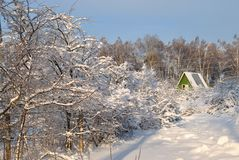 Snow covered country house Royalty Free Stock Image